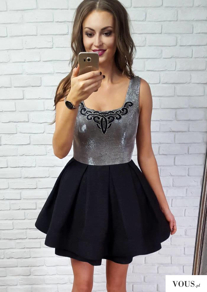 Ekskluzywna rozkloszowana sukienka z kontrafałdami, z podwójną spódnicą, wykonaną z czarnej tkan ...