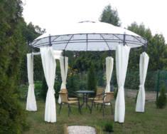 Oryginalny pawilon ogrodowy z okrągłym dachem sprawi, że nasz kącik wypoczynkowy w ogrodzie będz ...