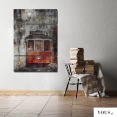 Obraz stworzy z grafiki, przedstawiający czerwony tramwaj o bardzo artystycznym charakterze.