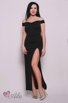 Długa, elegancka sukienka z seksownym rozcięciem. Wykonana z elastycznego materiału, dzięki czem ...